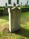 Kvarter E, kyrkogårdens äldsta daterade gravsten.