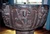 Dopfuntens reliefer: S:t Mikaels strid med draken.