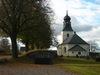 Regna kyrka och bisättningskällare från öster.