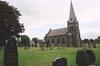 Trönninge kyrka med omgivande kyrkogård sedd från nordväst.