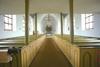 Kyrkorummet sett från väster, under läktaren.