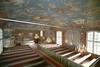 Kyrkorummet sett mot koret från orgelläktaren i väster.