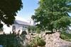 Kyrkan med omgivande kyrkogård sedd från nordost.