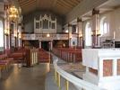 Vrigstad kyrkas interiör präglas huvudsakligen av den restaurering som arkitekt Lars Stalin ledde 1962. Mot läktaren.