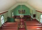 Kyrkorummet är mycket enkelt och sparsmakat. Ursprungligen var det ännu mer anspråkslöst och färgsatt i lugna dämpade grå toner. Den kraftiga färgsättningen i rött och grönt som tillkom under Bengt Lidströms restaurering på 1970-talet förtar en del av kyrkans autenticitet, men i övrigt har mycket få förändringar skett invändigt. Vid invigningen saknades ljuskronor och lampetter. Elektricitet installerade först 1982. Uppvärm-ningen ändrades 1974 och samtidigt ersattes den ursprungliga altar-prydnaden i form av ett enkelt träkors med den nuvarande textilen. Korset placerades istället i sakristian