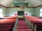 På läktaren över vapenhuset står den orgel som orgelfirman J.P Nyström skänkte till kyrkan inför invigningen.