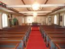 Kyrkorummet är välbevarat och präglas främst av det låga spegelvalvet, valvlisten med klot, de kraftiga hanbjälkarna samt den mustiga färgsättningen med mycket marmoreringar. Utbyggnaden av ett smalare kor 1972 innebar att den ursprungliga perspektivmålningen på korväggen försvann. I övrigt är kyrkorummet mycket välbevarat. Stilmässigt framstår det som att hela kyrkorummet, med sin historicerande och barockmässiga utformning, har anpassats till predikstolen.