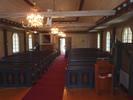 I bakre delen av kyrkorummet är det främst orgeln som negativt påverkat symmetrin. Några bänkrader togs bort för att rymma den. Med tanke på att predikstolen är kyrkans förnämsta inventarie och att den är väldigt låg kan man ifrågasätta om det verkligen är nödvändigt med en ambo dessutom.