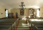 Trots de genomgripande förändringarna av interiören på 1930-talet uppfattar man fortfarande kyrkorummet som ålderdomligt, mycket tack vare den låga takhöjden och avsaknaden av läktare, samt predikstolen som flyttades från Volgsjö 1700-talskapell när det revs några år efter att Dikanäs kyrka uppförts. Stora delar av kyrkorummets inredning är från K.M. Westerbergs restaurering 193234, däribland golvet, väggpanelen, bänkarna, altarringen, altartavlan och troligen även ljuskronorna. De har dock mer av ett traditionellt än ett modernistiskt formspråk. Kororgeln från 1985 avviker däremot från den ålderdomliga prägeln och är tydligt exponerad genom sin storlek och placering.