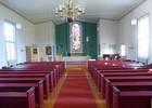 Vid den genomgripande restaureringen 1960 förändrades särskilt koret och färgsättningen. Den säregna predikstol som ursprungligen fanns på södra väggen revs och en ny enklare predikstol byggdes på norra sidan. Södra korfönstret flyttades och istället tog man upp nischen och placerade det målade rundbågiga korfönstret där. De främre bänkarna demonterades, koret breddades och den nuvarande altarringen tillkom. Färgsättningen justerades och blev mer koloristisk, i synnerhet bänkkvarteren. Kyrkorummet skulle vinna på att de två målningarna i koret flyttades till serveringsrummet. Målningen bakom predikstolen stjäl uppmärksamhet från altarfönstret.