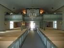 I bakre delen av kyrkorummet är den största förändringen läktaren som byggdes 1877 och byggdes till i mittsektionen 1931 för att rymma en ny orgel. Räckeshöjningen har inneburit en visuell försämring både genom sin väl tilltagna höjd, dimension och avvikande grönton.