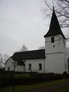 Kyrkan sedd från NV.