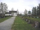 Ånge kyrka med omgivande kyrkogård samt klockstapel, vy från söder.