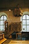 Predikstolen är ett verk av Michael Schmidt, inköpt till kyrkan år 1751.